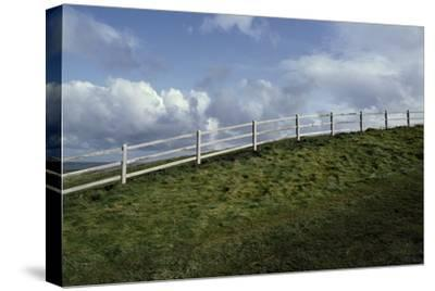 A Fence Along a Ridgeline-Macduff Everton-Stretched Canvas Print