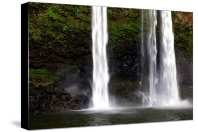 A Man Stands under Wailua Falls-Ben Horton-Stretched Canvas Print