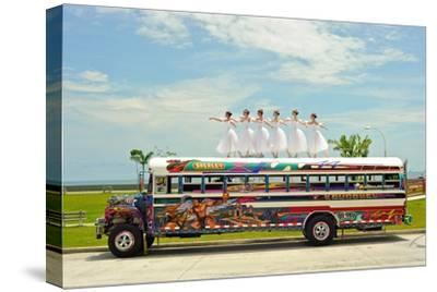 Ballerinas Dance on Top of a Diablo Rojo Bus on La Cinta Costera, Panama's Coastal Highway-Kike Calvo-Stretched Canvas Print