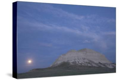 A Butte and the Full Moon in the Oglala National Grassland-Phil Schermeister-Stretched Canvas Print