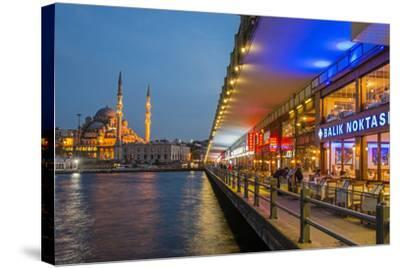 Outdoor Restaurants under Galata Bridge with Yeni Cami or New Mosque at Dusk, Istanbul-Stefano Politi Markovina-Stretched Canvas Print
