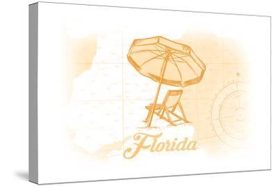 Florida - Beach Chair and Umbrellas - Yellow - Coastal Icon-Lantern Press-Stretched Canvas Print