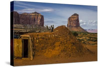 Native American Hogan's and Mitchell Butte in Monument Valley Tribal Park of the Navajo Nation, Az-Jerry Ginsberg-Stretched Canvas Print