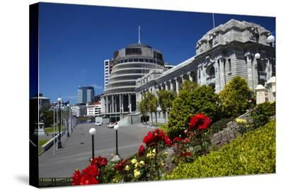 The Beehive and Parliament House, Wellington, North Island, New Zealand-David Wall-Stretched Canvas Print