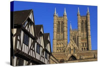Half-Timbered Leigh-Pemberton House and Lincoln Cathedral, England-Eleanor Scriven-Stretched Canvas Print