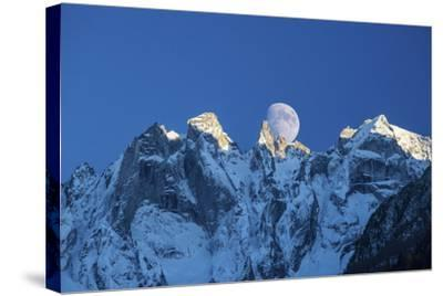 The Moon Appears Behind the Snowy Mountains Illuminating the Peaks-Roberto Moiola-Stretched Canvas Print