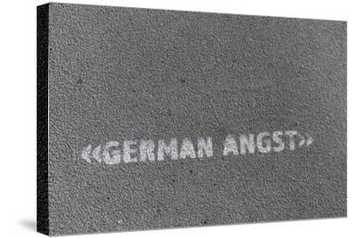 Writing 'German Angst' on a Footpath, Hamburg, Germany-Axel Schmies-Stretched Canvas Print