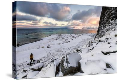 Photographer on the Snow Admires the Fishing Village under a Colorful Sky Eggum-Roberto Moiola-Stretched Canvas Print