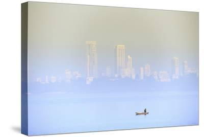 A Fisherman in Front of the Skyscrapers of the Malabar Hills in Mumbai (Bombay), Maharashtra, India-Alex Robinson-Stretched Canvas Print