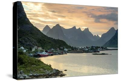 Sunset on the Fishing Village Surrounded by Rocky Peaks and Sea, Reine, Nordland County-Roberto Moiola-Stretched Canvas Print