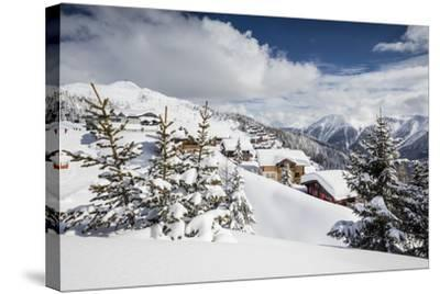 The Winter Sun Shines on the Snowy Mountain Huts and Woods, Bettmeralp, District of Raron-Roberto Moiola-Stretched Canvas Print