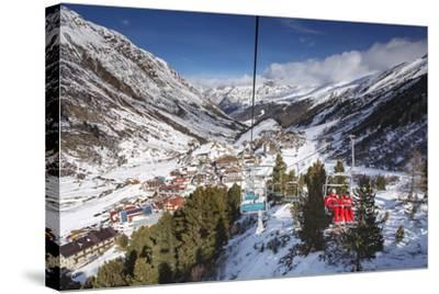 Village of Obergurgl Sat at Top of Otztal Valley as Skiers Ascend Mountain on Chairlifts-Garry Ridsdale-Stretched Canvas Print