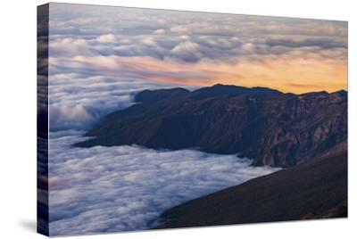 Clouds Obscure Coastal Villages Below Dark Volcanic Mountains of Tenerife's North East Coast-Garry Ridsdale-Stretched Canvas Print