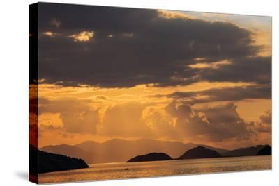 Indonesia, Lesser Sunda Islands, Rinca. Sunset over Komodo Island.-Nigel Pavitt-Stretched Canvas Print
