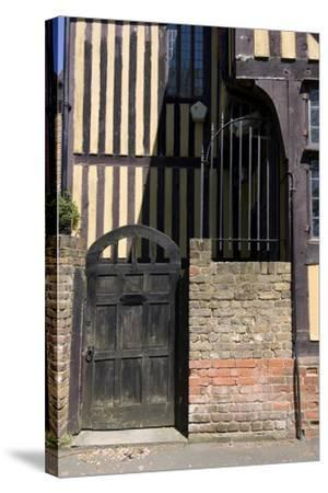 Timber Framed Building with Gate and Brick Wall in Tudor-Style House-Natalie Tepper-Stretched Canvas Print