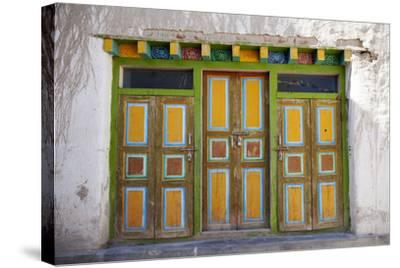 Nepal, Mustang, Lo Manthang. Brightly Painted Doors in the Ancient Capital of Lo Manthang.-Katie Garrod-Stretched Canvas Print