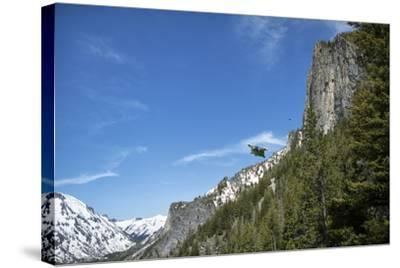A Wingsuit Pilot Flying Near a Mountain-Chad Copeland-Stretched Canvas Print