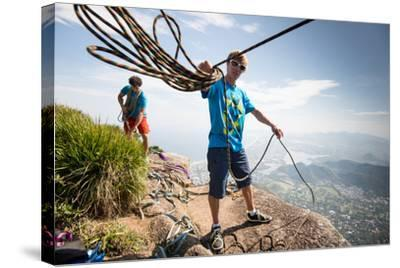 Young Man Standing on Top of the Mountain Holding Rope for Slacklining-Keith Ladzinski-Stretched Canvas Print