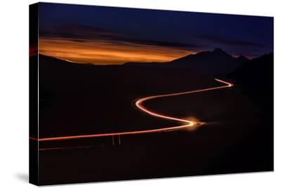 Road with Headlights and Taillights in Rocky Mountain National Park at Sunset, Colorado-Keith Ladzinski-Stretched Canvas Print