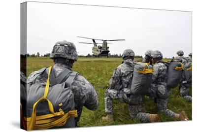 U.S. Army Paratroopers Prepare to Board a Ch-47 Chinook-Stocktrek Images-Stretched Canvas Print