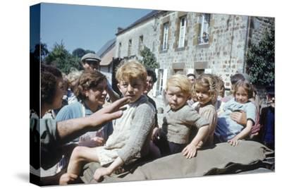 French Children in the Town of Avranches Sitting on Us Military Jeep, Normandy, France, 1944-Frank Scherschel-Stretched Canvas Print