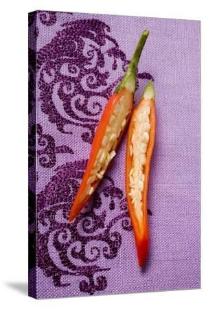 Red Chili Pepper, Halved, on Purple Fabric-Foodcollection-Stretched Canvas Print