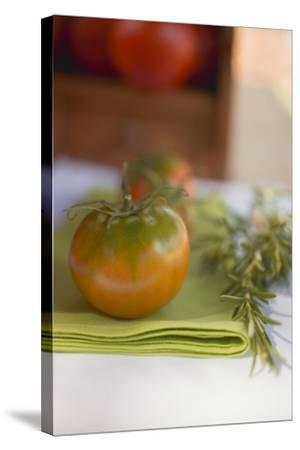 Green Tomatoes on Green Napkin on Table Out of Doors-Foodcollection-Stretched Canvas Print