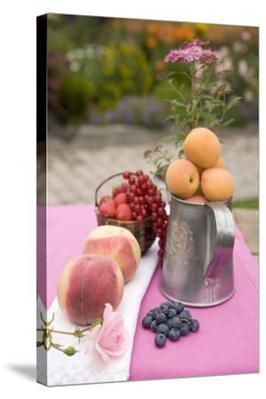 Peaches, Apricots and Fresh Berries on Table Out of Doors-Foodcollection-Stretched Canvas Print