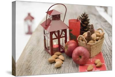 Christmas Decoration with Apples, Nuts and Lantern on Table-Foodcollection-Stretched Canvas Print