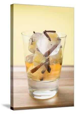 Rum and Ice Cubes with Spices and Pieces of Fruit in Glass-Foodcollection-Stretched Canvas Print