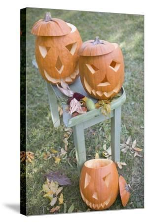 Carved Pumpkin Faces on Garden Table-Foodcollection-Stretched Canvas Print