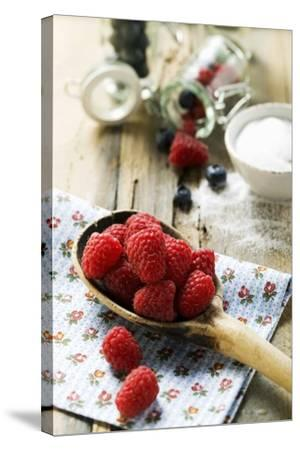 Fresh Raspberries on a Wooden Spoon-Foodcollection-Stretched Canvas Print