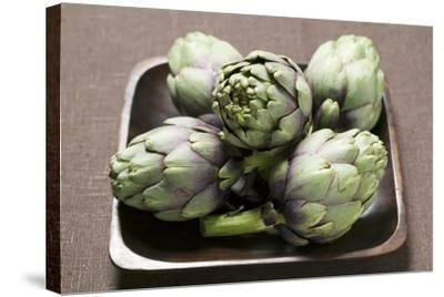 Five Artichokes in Bowl-Foodcollection-Stretched Canvas Print