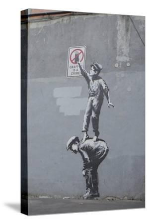Graffiti Is a Crime-Banksy-Stretched Canvas Print