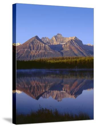 Canada, Alberta, Banff National Park, Sunrise Light on the Bow Range Reflects in Herbert Lake-John Barger-Stretched Canvas Print
