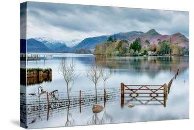 A Scenic Landscape View of Derwentwater, Winter with a Flooded Field and Gate-Julian Eales-Stretched Canvas Print