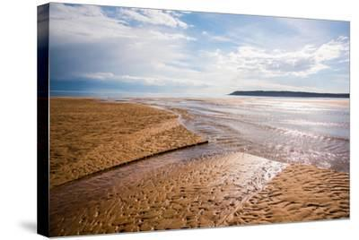 Pennard Pill Meets the Bristol Channel at Three Cliffs Bay, Gower, South Wales, UK-Nigel John-Stretched Canvas Print
