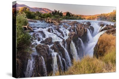 Multiple Streams Comprise the Epupa Fall-David Kettles-Stretched Canvas Print