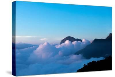 Mountain Peaks Appear Out of Dense Clouds-Prasenjeet Yadav-Stretched Canvas Print