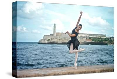 A Classical Ballerina from the Cuba National Ballet at the Malecon-Kike Calvo-Stretched Canvas Print