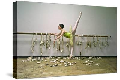 A Ballerina Poses with All the Pointe Shoes She Used in Her Career-Kike Calvo-Stretched Canvas Print
