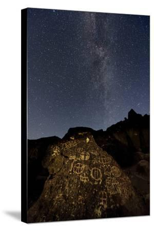 The Milky Way Above an Ancient Native American Petroglyph in the Owens Valley of Sierra-Babak Tafreshi-Stretched Canvas Print