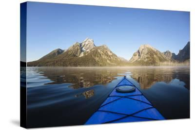 Sea Kayaking Jackson Lake In Grand Teton National Park, WY-Justin Bailie-Stretched Canvas Print