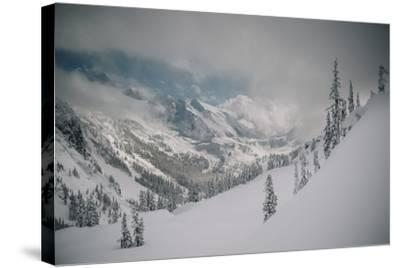 Skier Makes Some Steep Angle Powder Turns In Cascades Of Washington As A Snow Storm Begins To Clear-Jay Goodrich-Stretched Canvas Print