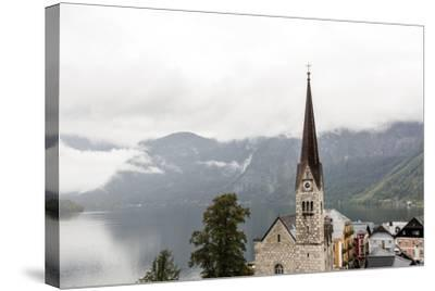 Hallstatt, Salzkammergut Region, Austria: Village By Lake On A Rainy Day With Low-Hanging Clouds-Axel Brunst-Stretched Canvas Print