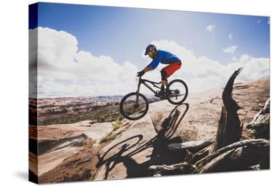 Ben Duke Mountain Biking Captain Ahab Trail, Moab, Utah-Louis Arevalo-Stretched Canvas Print