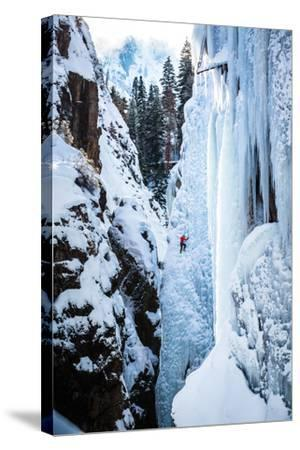 An Ice Climber Ascends A Route In Ouray, Colorado-Dan Holz-Stretched Canvas Print