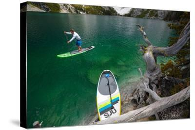 Man Paddle Boards Using Inflatable SUP, Colchuck Lake Alpine Lakes Wilderness Of The Cascade Range-Ben Herndon-Stretched Canvas Print