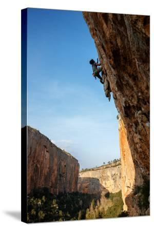 A Man Rock Climbs In The Beautiful Limestone Canyons Of Chulilla, Spain-Ben Herndon-Stretched Canvas Print