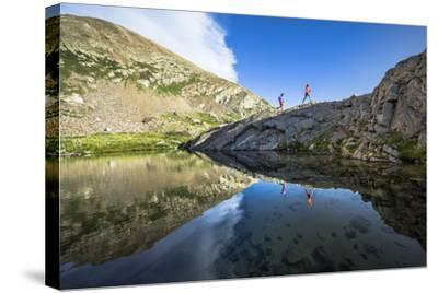 Mayan Smith-Gobat & Ben Rueck Go For High Elevation Trail Run, Backcountry Of Above Marble, CO-Dan Holz-Stretched Canvas Print